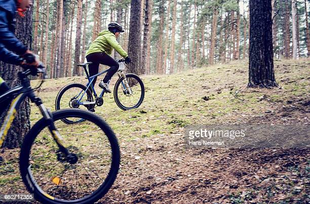 Boys riding mountain bike, outdoors