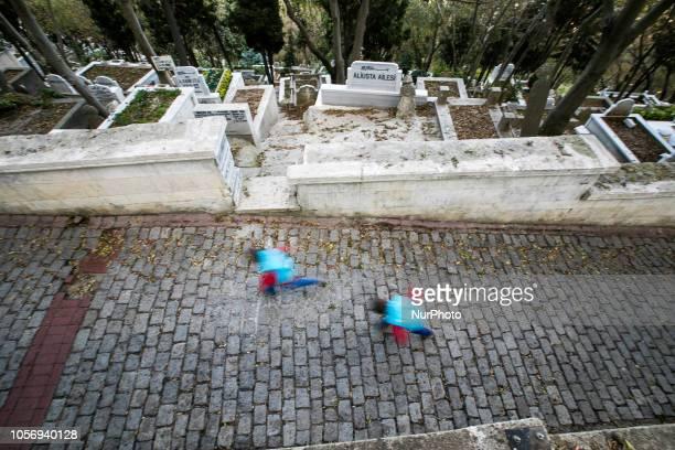 Boys run at the cemetery in Eyup Istanbul on
