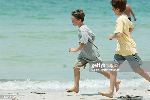 Boys running on beach