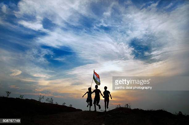 boys running with indian flag - indian flag stock pictures, royalty-free photos & images