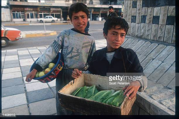 Boys sell fruits and vegetables April 16 1996 in Arbil northern Iraq Efforts by the Kurds to achieve autonomy or independence for the region have...