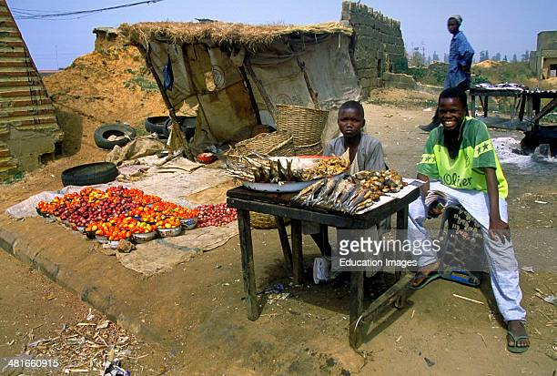 Boys selling fish near the Kuyanbana Gate in Kaduna northern Nigeria Hausa Territory West Africa