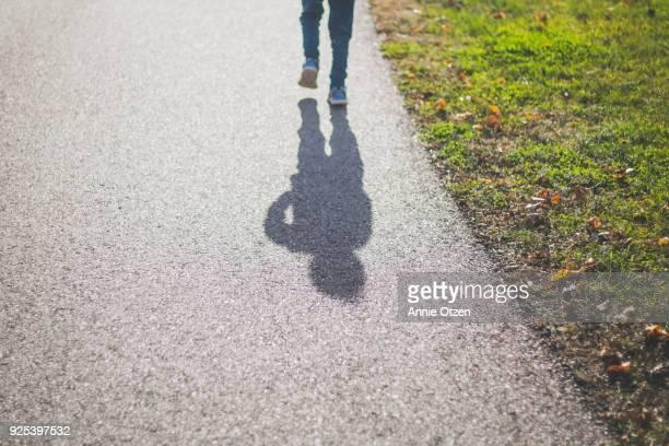 Boy's Shadow Walking Away