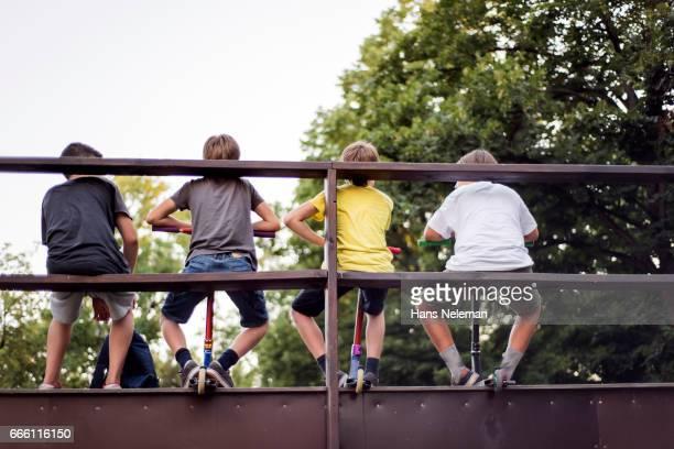Boys sitting in the skate park