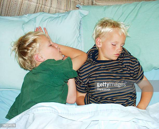 Boys sleeping in bed