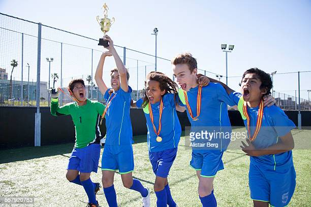 boys soccer team celebrate winning - teen awards stock photos and pictures