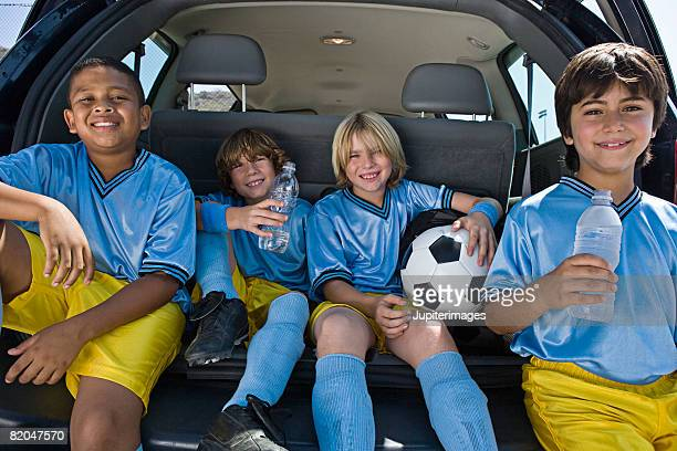 boys' soccer team in car - football team stock pictures, royalty-free photos & images