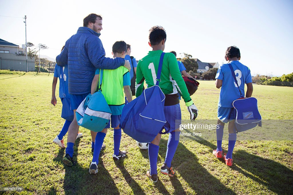 Boys soccer team preparing for a game : Stock Photo