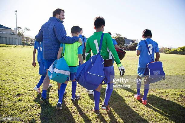 boys soccer team preparing for a game - coach stock pictures, royalty-free photos & images