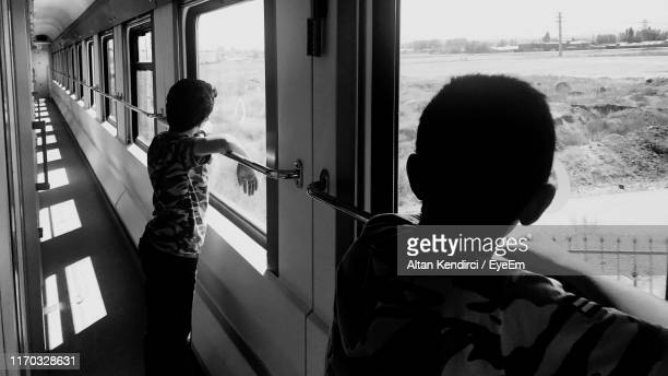 boys standing by window in train - anatolia stock pictures, royalty-free photos & images