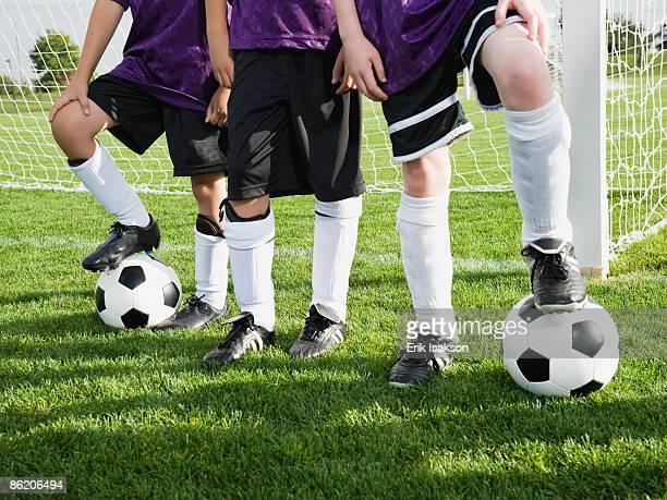 Boys standing near goal on soccer field