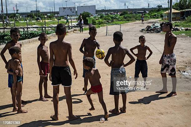 Boys start playing football in a shantytown of Olinda about 18 km from Recife in northeastern Brazil on June 18 2013 as the FIFA Confederations Cup...