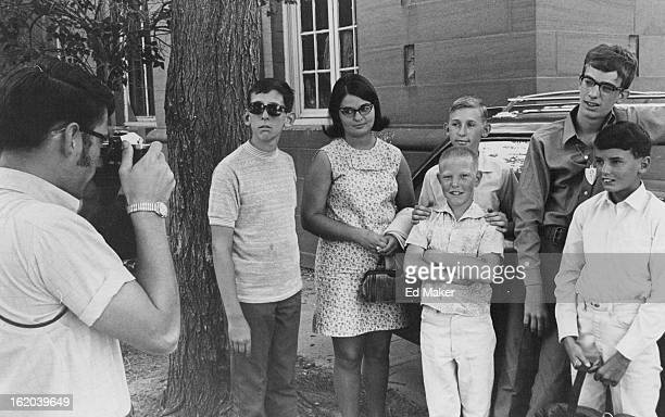 AUG 11 1969 AUG 12 1969 Boys Start Trip to Hawaii Glen Leinbach cottage parent takes a picture of a group from Clayton College for Boys 3801 E 32nd...