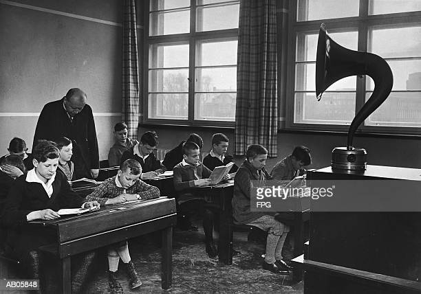 boys (10-12) studying in music class with teacher (b&w) - picture of phonograph stock photos and pictures