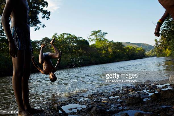 Boys swim in Gojeb river in a nature biosphere on December 8, 2012 outside Gojeb, Ethiopia. This Kaffa region is known for its coffee production,...