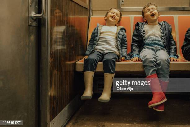 boys taking the subway - new york city subway stock pictures, royalty-free photos & images
