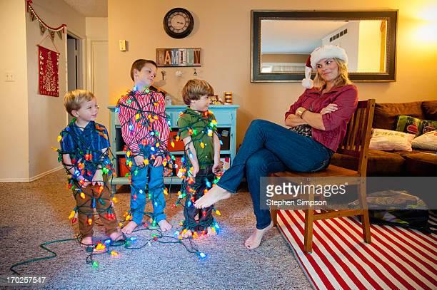 boys tied up in strings of christmas lights - junge gefesselt stock-fotos und bilder
