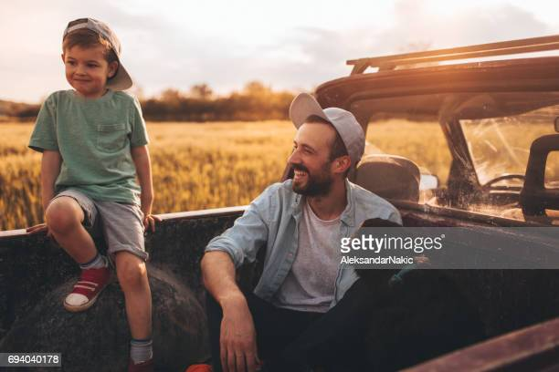 boys time! - happy family in car stock photos and pictures