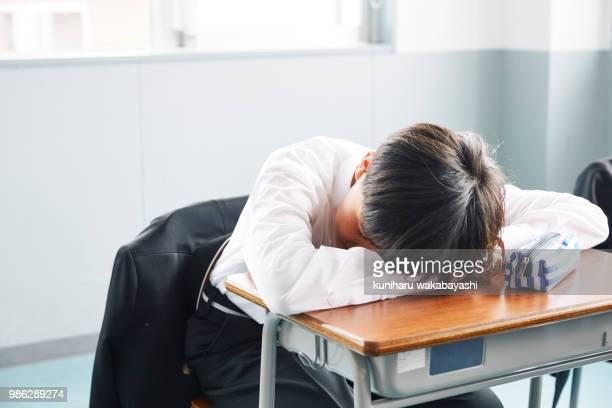 boys to sleep in the classroom - 男子生徒 ストックフォトと画像
