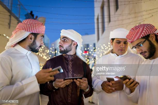 boys together out with smart phones in hands - youth culture stock pictures, royalty-free photos & images