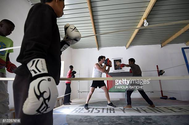 Boys train at a boxing gym in the Smara refugee camp in Algeria's Tindouf province on February 25 2016 / AFP / Farouk Batiche