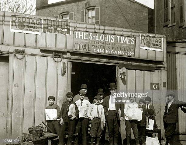 Boys wait outside of a Coal Shed Office that also serves as a depot for the newsboys to pickup their papers ie the St Louis Times