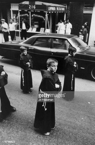 Boys walk in religious robes as part of the Feast of St Anthony of Padua Procession Greenwich Village New York City 1975