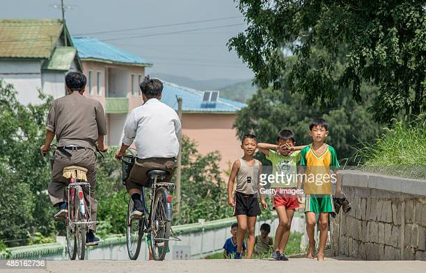Boys walk on street on August 23 2015 in Pyongyang North Korea North and South Korea today came to an agreement to ease tensions following an...