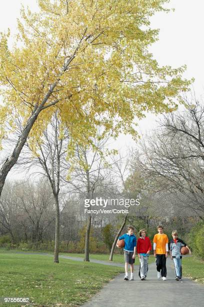 boys walking in park - climat stock pictures, royalty-free photos & images