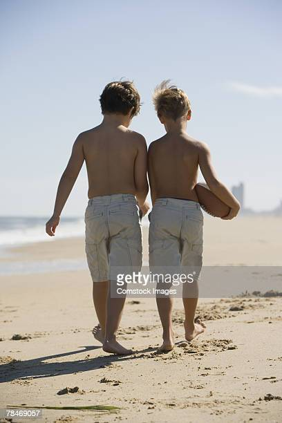 Boys walking on beach