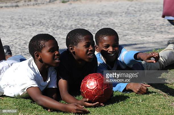 Boys watch a football match in the Gugulethu township outside of Cape Town on December 2 2009 With the draw for the World Cup 2010 turning Cape Town...