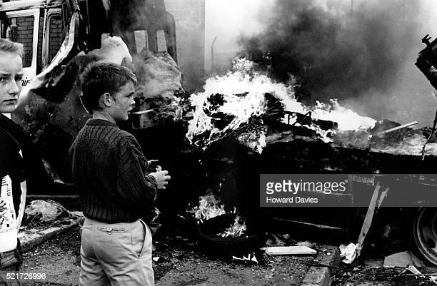 boys watching lorry burn during riot in west belfast - falls road stock pictures, royalty-free photos & images
