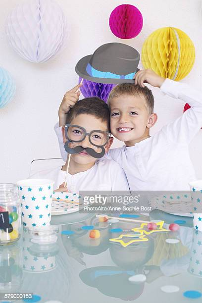 Funny birthday images free stock photos and pictures getty images boys wearing funny disguises at birthday party voltagebd Gallery