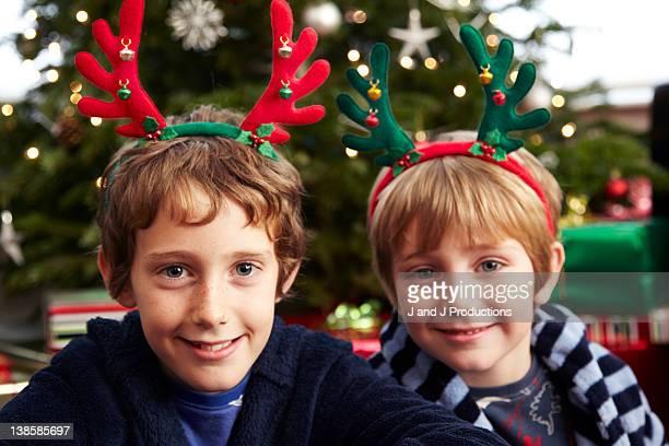 Boys wearing reindeer antlers
