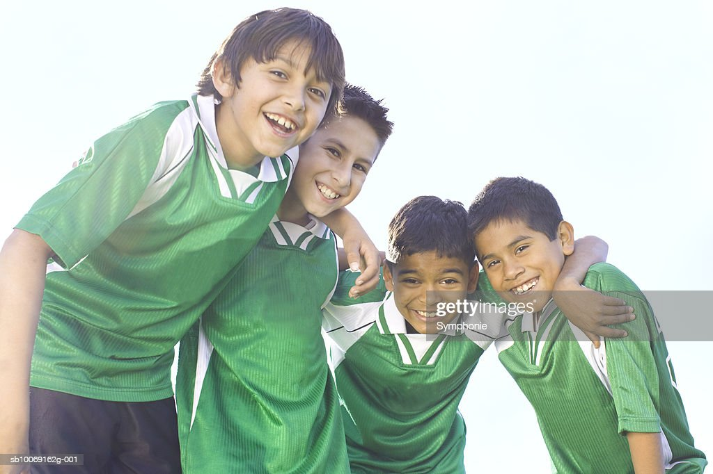 Boys wearing soccer uniform smiling, portrait : Stockfoto