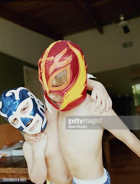 Boys (3-6) wearing wrestling masks