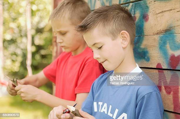 Boys whittling sticks