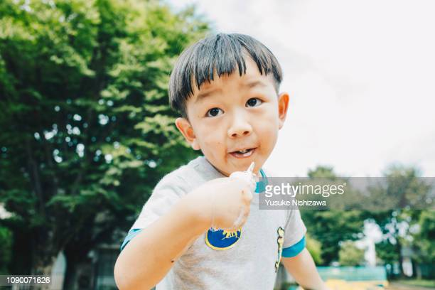 a boys who eat ice cream - yusuke nishizawa bildbanksfoton och bilder