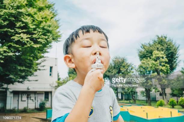 a boys who eat ice cream - yusuke nishizawa stock pictures, royalty-free photos & images