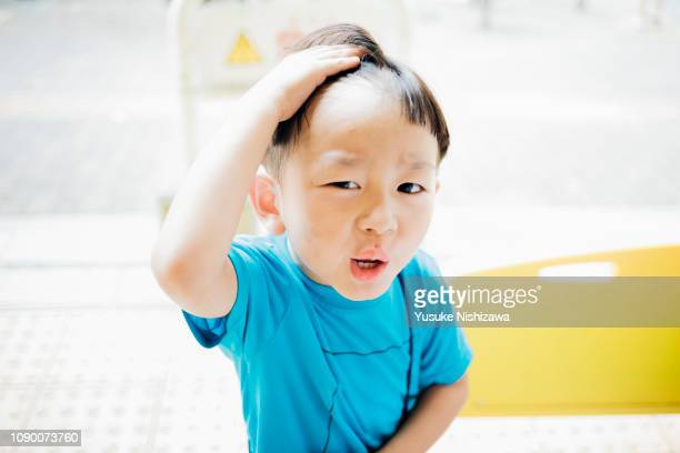 a boys who eat ice cream - yusuke nishizawa stock pictures, royalty-free photos & images