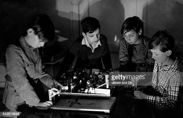 Boys with a selfmade model of a town original text 'Modern schools' Photographer Charlotte Willott Published by 'Die Gruene Post' 19/1932Vintage...