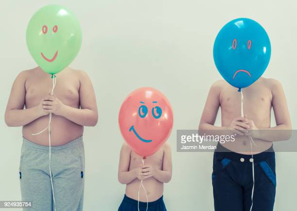 Boys with balloons and smilies on