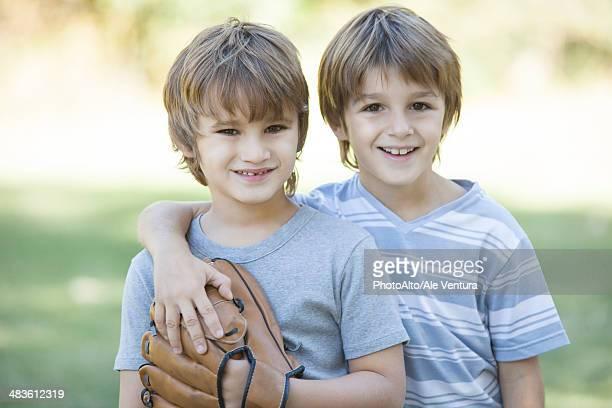 Boys with baseball glove, portrait