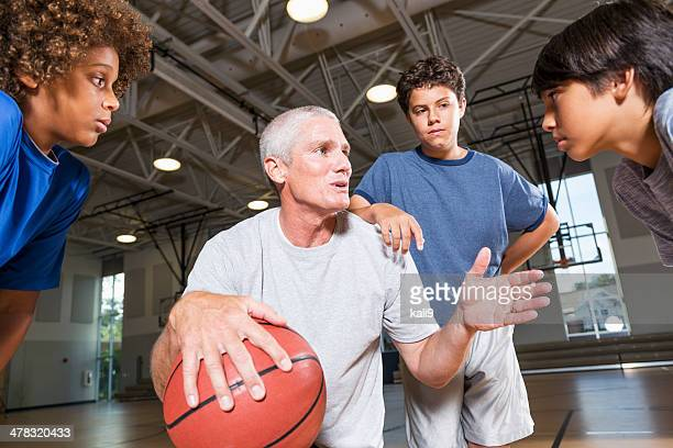 Boys with basketball coach