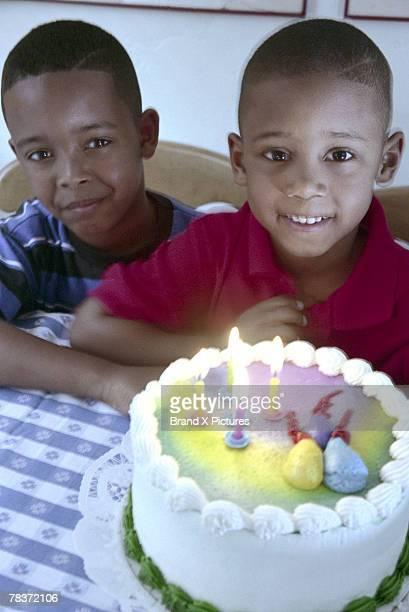 Boys with birthday cake