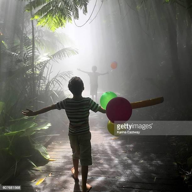 Boys with cricket bat & balloons close up