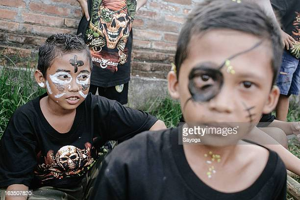 Boys with painted faces during Ogoh-ogohs parade on March 11, 2013 in Tunjuk Village, Tabanan, Bali, Indonesia. For the Balinese, Ogoh-ogohs reflect...