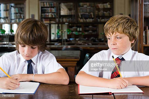 boys working - bad student stock pictures, royalty-free photos & images