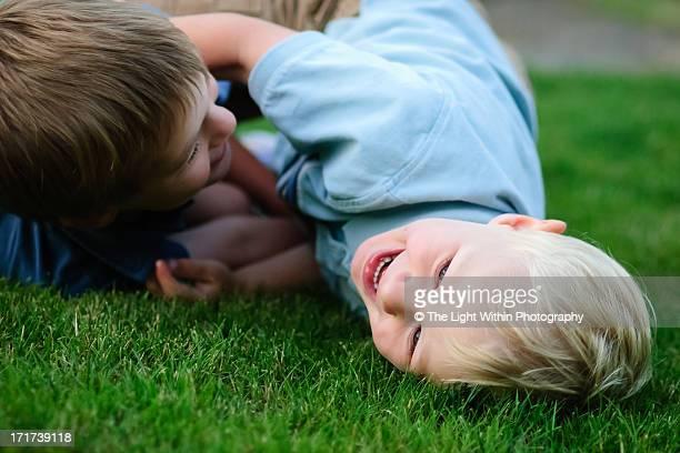 Boys wrestling on the grass