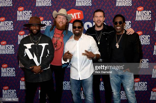 Boyz II Men and Brothers Osborne attend the 2019 CMT Music Awards Executives at Bridgestone Arena on June 05 2019 in Nashville Tennessee